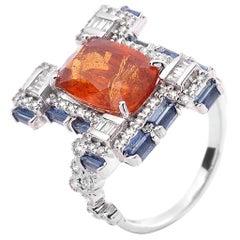 Trinity 18 Karat WG Ring with Mandarin Garnet, Blue Sapphire and Diamond