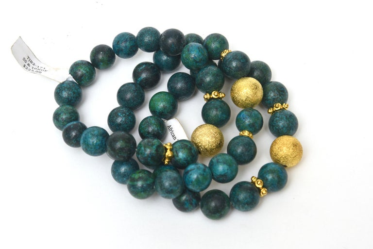 These never worn set of 3 African turquoise beaded bracelets with interspersed gold filled fragments are stretch.These were once in a boutique shop on a 5 star cruise but were never sold. They have their original tags on them for $225.00 each. They