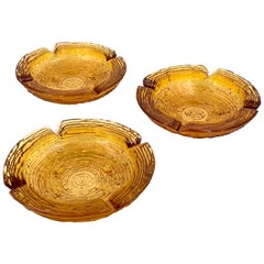 Trio of American Midcentury Textured Amber Glass Ashtrays