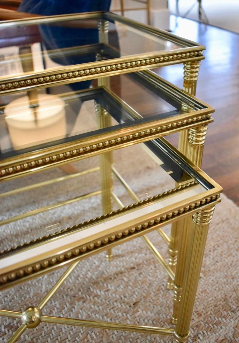 Mid-20th Century Trio of Maison Jansen Style French Brass Nesting Tables For Sale