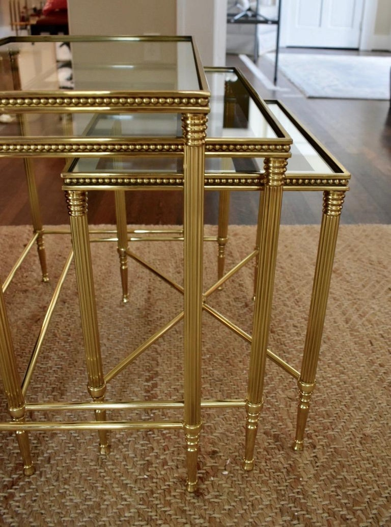 Glass Trio of Maison Jansen Style French Brass Nesting Tables For Sale