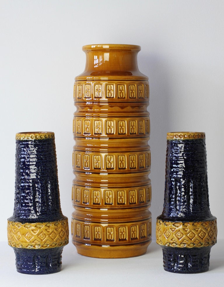 Trio of tall vintage midcentury vases by West German Pottery producers - 'Bay Keramik' and 'Spara', Germany, circa 1970s. The embossed relief pattern on the pair of Spara vases is not dissimilar to the style of Italian pottery designer Aldo Londi