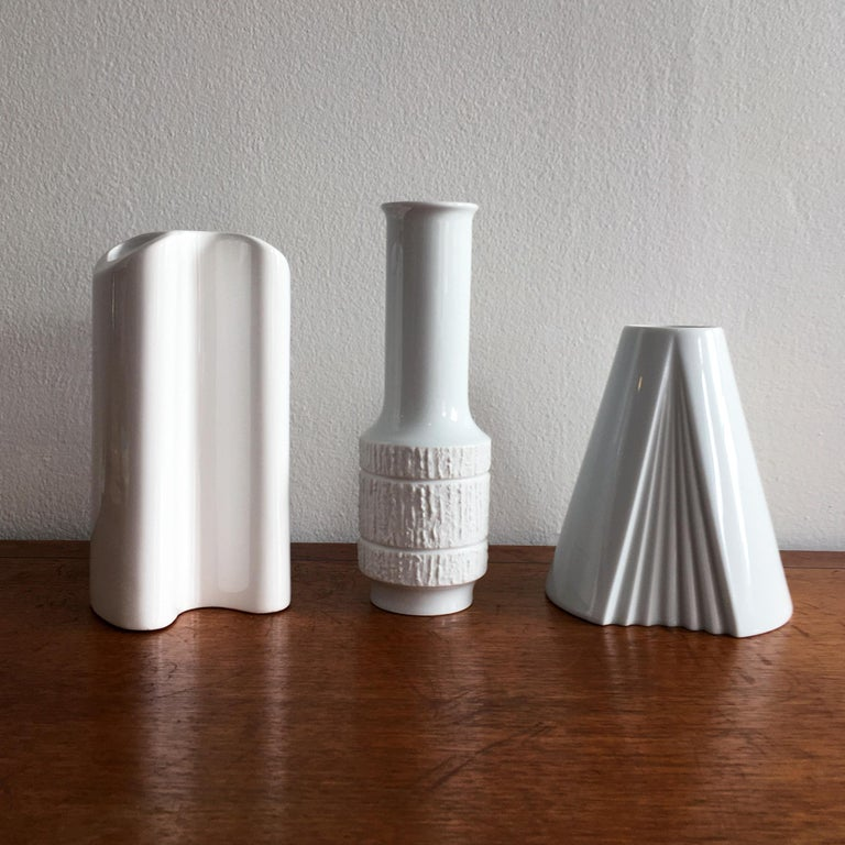 Trio of white vases including Thomas textured bisque detail vase by Richard Scharrer, Dansk curved design vase, Rosenthal Plissee vase by Ambrogio Pozzi. The shapes and textures of this trio beautifully complement each other.   Measurements: