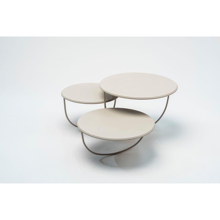 Trio side table by Nendo Materials: Top: Noce Canaletto solid wood, Glass or Metal  Structure: Black chrome metal, Black/Light grey NCS 2002 Y50R/Coral NCS 2570 Y70R /Dark   Green NCS 8010 B70G powder-coated metal Dimensions: W84.7 x D76.3 x