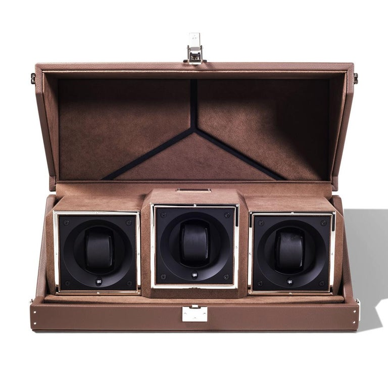Box triple Luxwatch brown covered with brown grained cowhide leather. With jewelry parts in solid brass, with hand polished nickel-plated. With bottom feet in hand- polished and nickel plated solid brass. Padding and lining in brown slate