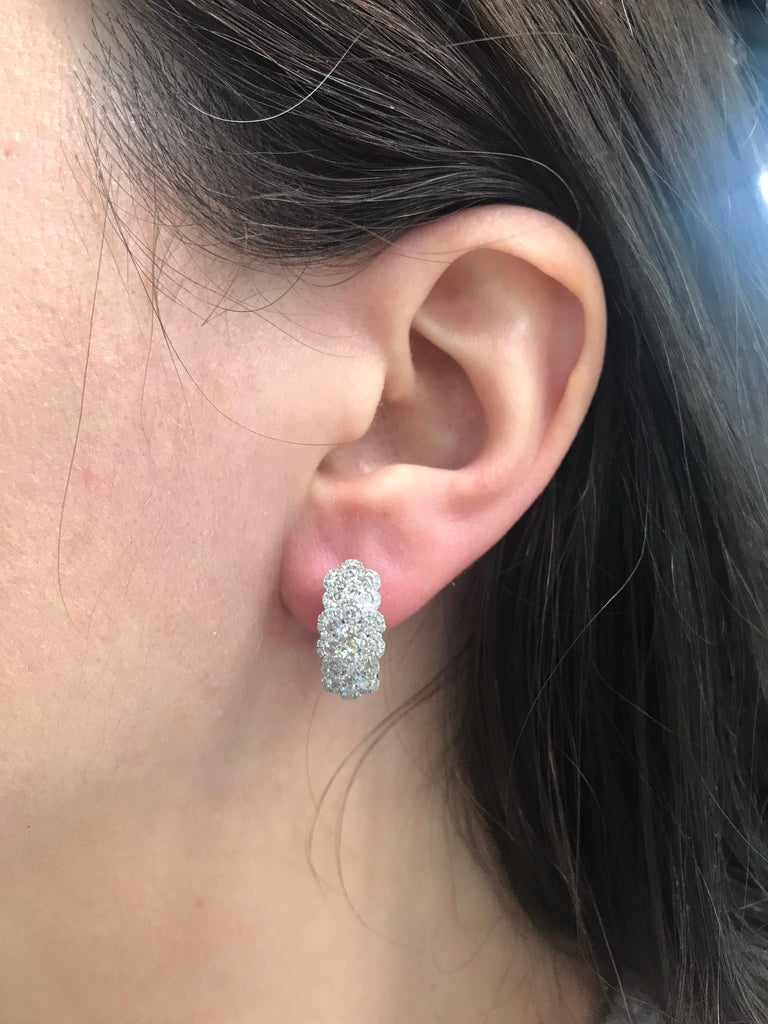 18k White gold hoop earrings featuring three rows of 188 round brilliants weighing 2.35 carats. Color G-H Clarity SI