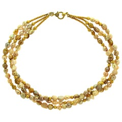 Triple-Strand Choker of Rosebud Multi-Color Pearls with Golden Accents