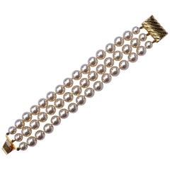 Triple Strand Knotted Faux Pearl Bracelet with a Fancy Gold Tone Clasp