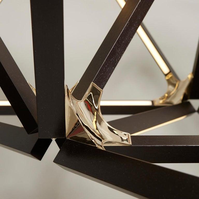 Hand-Crafted Triple X Chandelier Ebonized Oak Brushed Brass For Sale