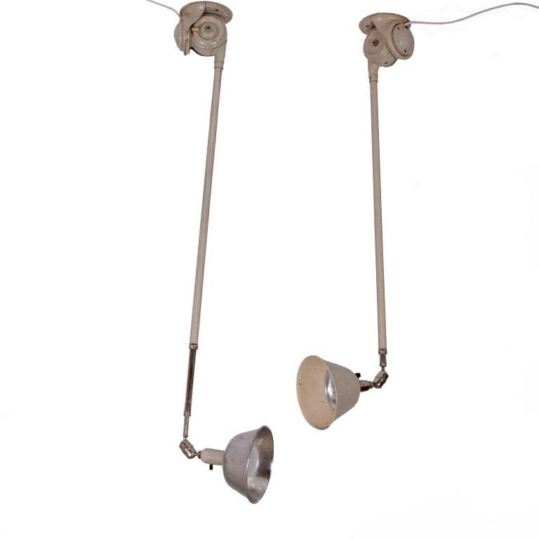 Painted metal lamp with aluminum shade and bakelite switch. Telescoping; can be used on wall or ceiling. 51
