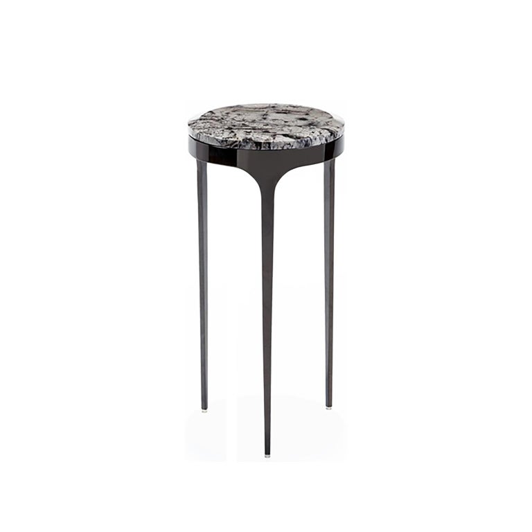 Tripod drink table with gunmetal base and marble top.