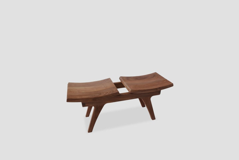 Tripot is a walnut bench with two seats designed by Arturo Verástegui for BREUR ESTUDIO. This piece is part of Diseño y Ebanistería, BREUR ESTUDIO first ever collection, in which they collaborated with top designers to achieve exceptional