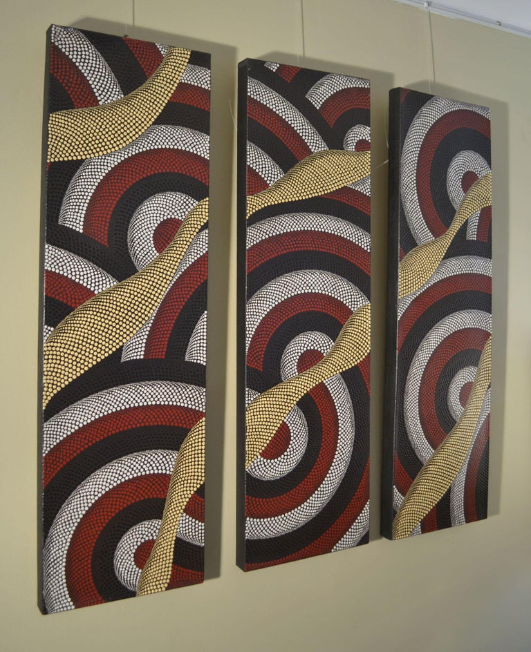 Aboriginal paintings triptych with dots in black, white, red and pale yellow on a black background. Their swirling lines create an optical illusion with the dots descending in size. The painting was purchased by the previous owner in the mid-1980s