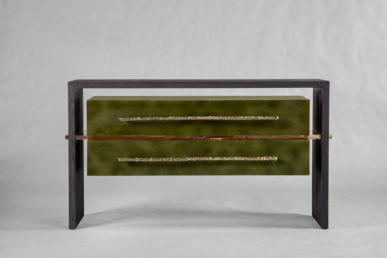 """Sand-blasted oak in a matte bark finish. A central polished bronze stretcher holds the two-drawer cabinet finished in a dark green """"Beka"""" lacquer with two long polished bronze handles. The insides of the drawers are lined with felt.  Custom sizes,"""