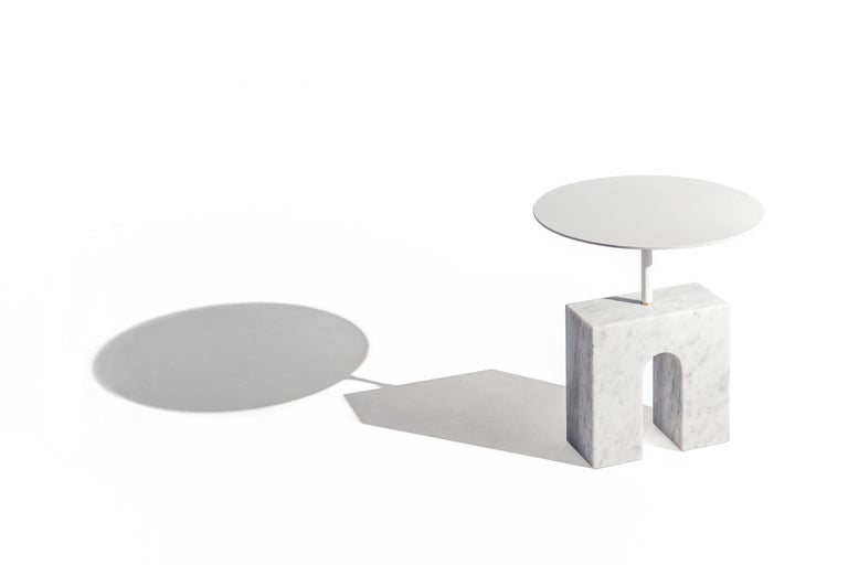 Triumph table a Minimalist style side table, made of marble and lacquered iron was inspired by the ancient civilizations of the Mediterranean area, where they develop the foundations of the concept of beauty that we have currently in Western
