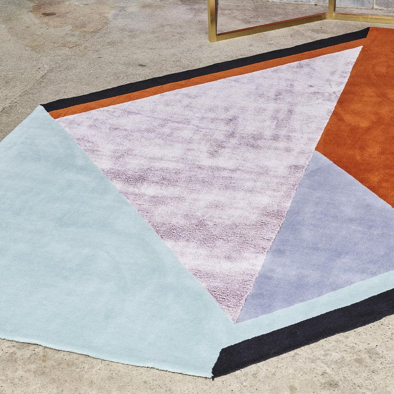 This unique rug was designed by Alquati+Corso and is part of the unconventional Roquebrune Collection. A piece of modern art for a refined home, this rug is handmade using New Zealand wool and Tencel, a new rayon material made with cellulose fiber.