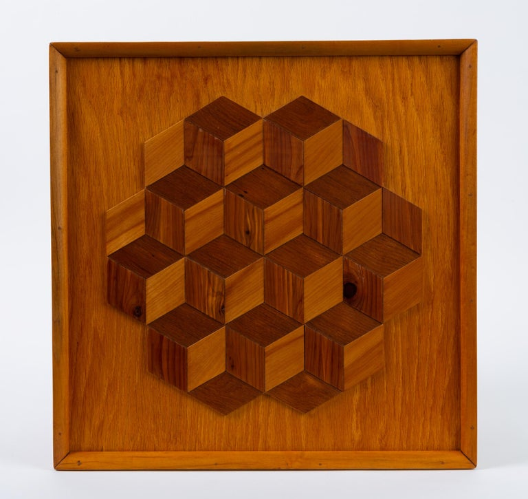 A modest piece of framed wall art with the traditional trompe l'oeil motif, the Louis cube, rendered in mixed wood veneer. The marquetry sits on a backing piece of oak veneer, with solid oak end pieces forming the frame. Unsigned.