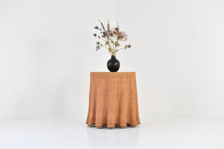 Rare Trompe L'Oeil wicker side table with 'draped' illusion from France, 1970's. This sculptural side table is in great original condition with only minor wear from age and use. Collector's item. Ideal size.