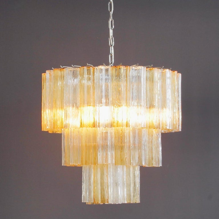 Chandelier with star-shaped 'Tronchi' glass pieces, Murano, Italy.  White metal structure with 48 Murano clear and amber glass pieces. Arranged over three layers. Chrome structure with six light fittings.