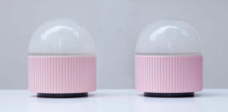 Vintage table lamps designed by Barbieri & Marianelli for Tronconi. Painted in pink with ribbed, aluminum structure with pressed acid etched glass diffuser.
