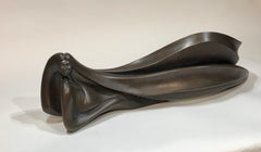 Elegance, by Troy Williams, bronze sculpture, reclining female figure, brown