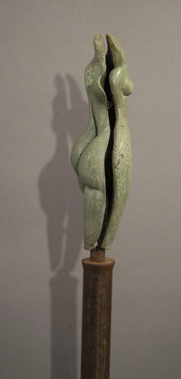 Sunrise, green concrete female nude form on steel column 2