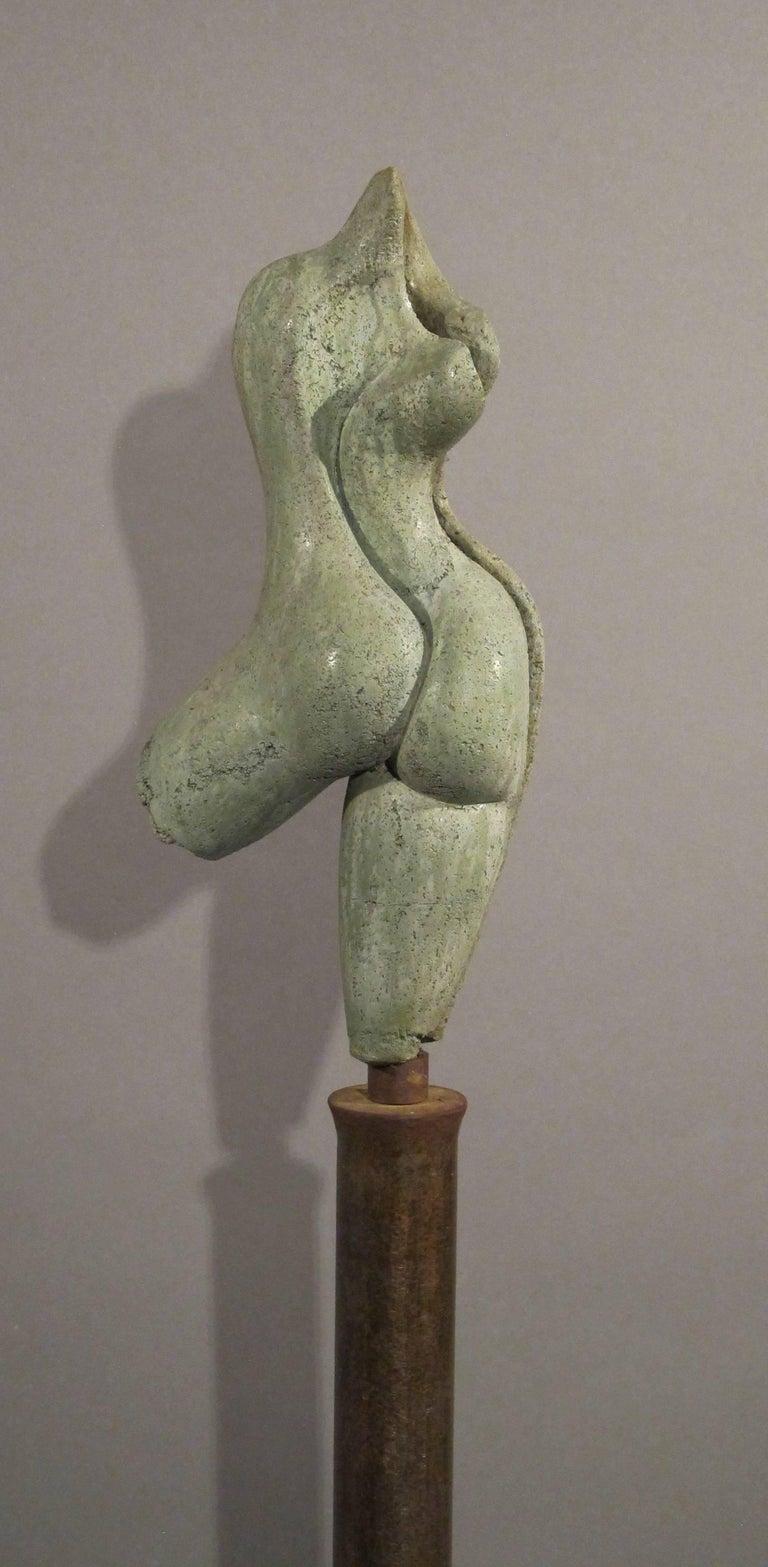 Sunrise, green concrete female nude form on steel column 3
