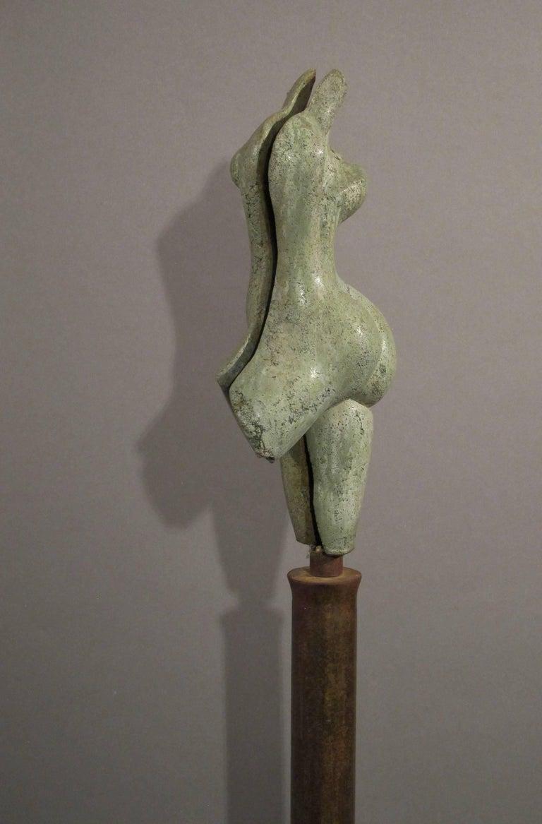 Sunrise, green concrete female nude form on steel column 4