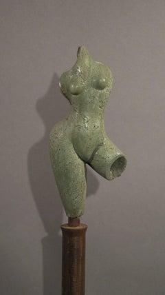 Sunrise, green concrete female nude form on steel column