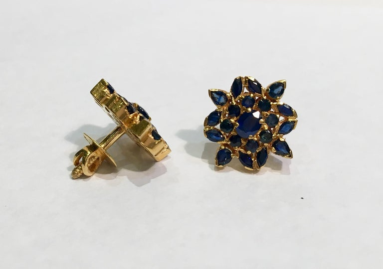 Oval Cut True Blue Sapphire Snowflake or Flower Style 22 Karat Yellow Gold Earrings For Sale