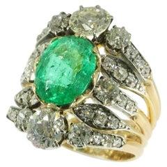 True Eye-Catcher Victorian Antique Ring with a 3.50 Carat Ovalcut Emerald