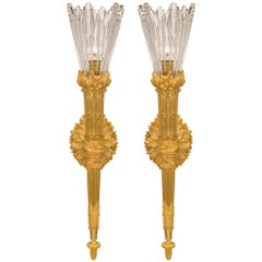 True Pair of French 19th Century Louis XVI Style Ormolu and Baccarat Sconces