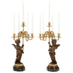True Pair of French 19th Century Louis XVI Style Winged Cherub Candelabras