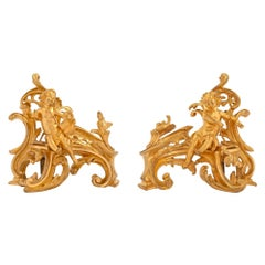 True Pair of French Early 19th Century Louis XV Style Ormolu Andirons