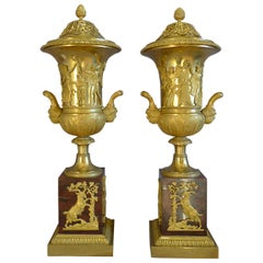 True Pair of Neoclassical Ormolu and Rouge Marble Covered Urns