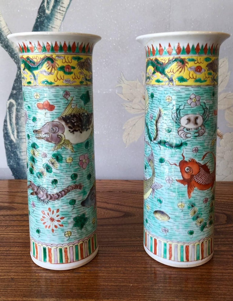 A pair of late 19th century famille verte trumpet shaped vases with design of shrimp, fish, and other sea life.