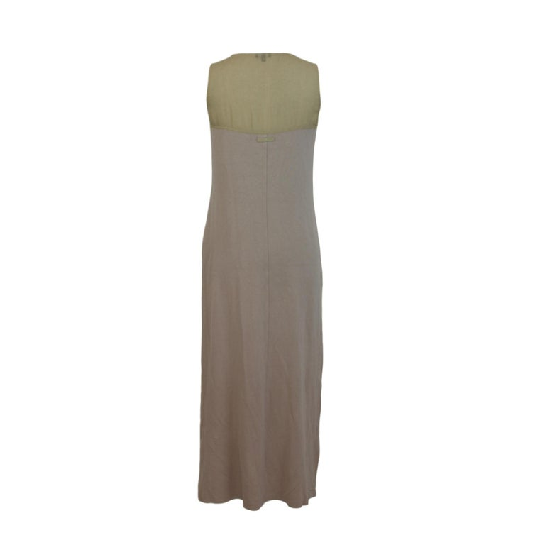 Trussardi long dress. Beige color, 100% cotton. Sleeveless dress, total length, on the chest transparent fabric, round neck. Made in Italy. Good vintage conditions.  Size 42 It 8 Us 10 Uk  Shoulders: 42 cm Chest / bust: 44 cm Sleeves: no Length: 133