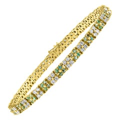 Tsavorite and Diamond Tennis Bracelet 14 Karat Yellow Gold 7 Inch