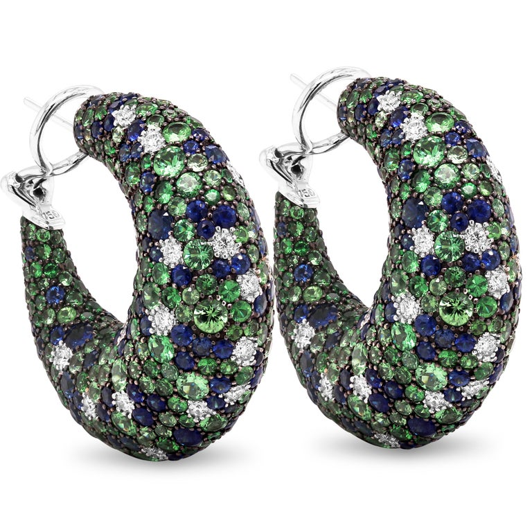 Tsavorite Blue Sapphire Diamond 18K White Gold Inside Out Hoop Earrings  These earrings are to die for with this exceptional design that features shaded Tsavorites from light to dark green mixed with the blue sapphires and diamonds. Stones are set