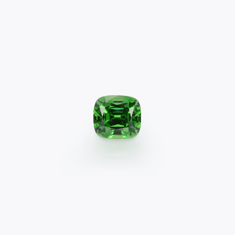 Alluring 3.18 carat Tsavorite cushion cut gem, offered loose to a very special lady or gentleman. Returns are accepted and paid by us within 7 days of delivery. We offer supreme custom jewelry work upon request. Please contact us for more