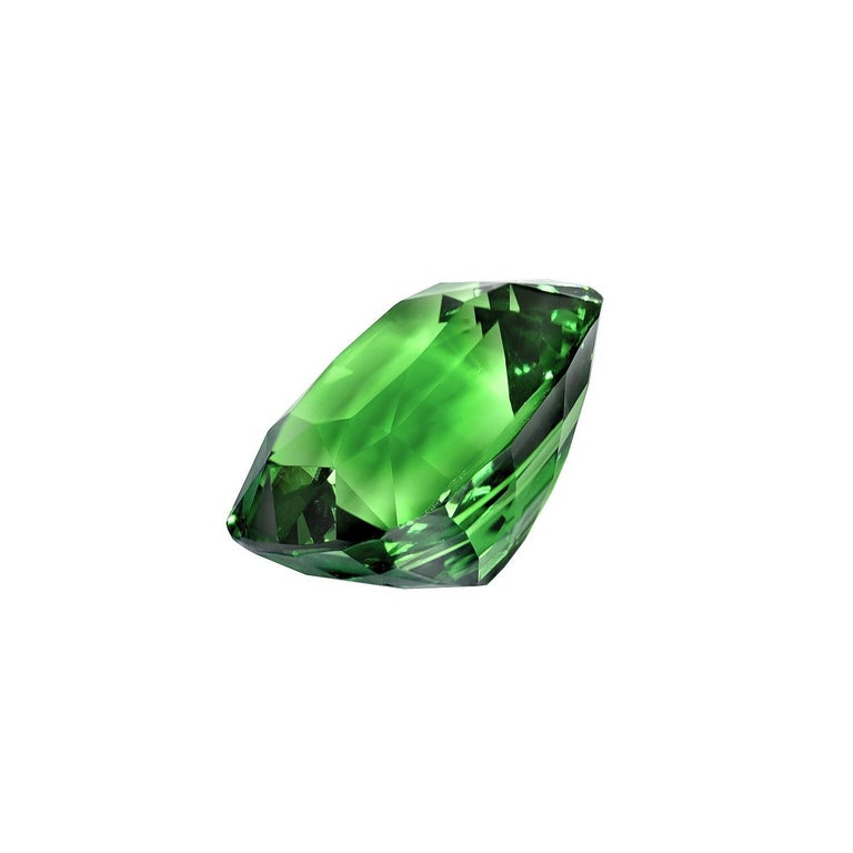 Fine 7.08 carat Tsavorite Garnet cushion cut gem, offered loose to a gemstone connoisseur. The GIA certificate is attached to the images for your reference, Returns are accepted and paid by us within 7 days of delivery. We offer ultra fine custom