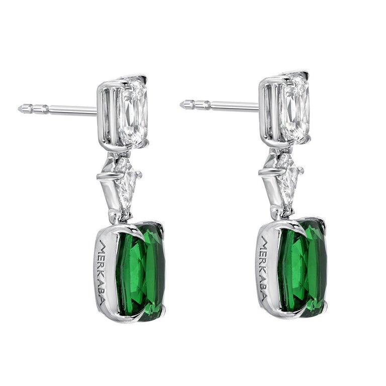 Rare vivid green pair of cushion cut Tsavorite Garnets weighing a total of 3.26 carats, are set in these remarkable 1.31 carat total diamond earrings. Crafted by extremely skilled hands in the USA. Approximately 0.80 inches in length. Returns are