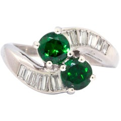 Tsavorite Garnet and Diamond Ring That Features 2 Round Tsavorite Garnets