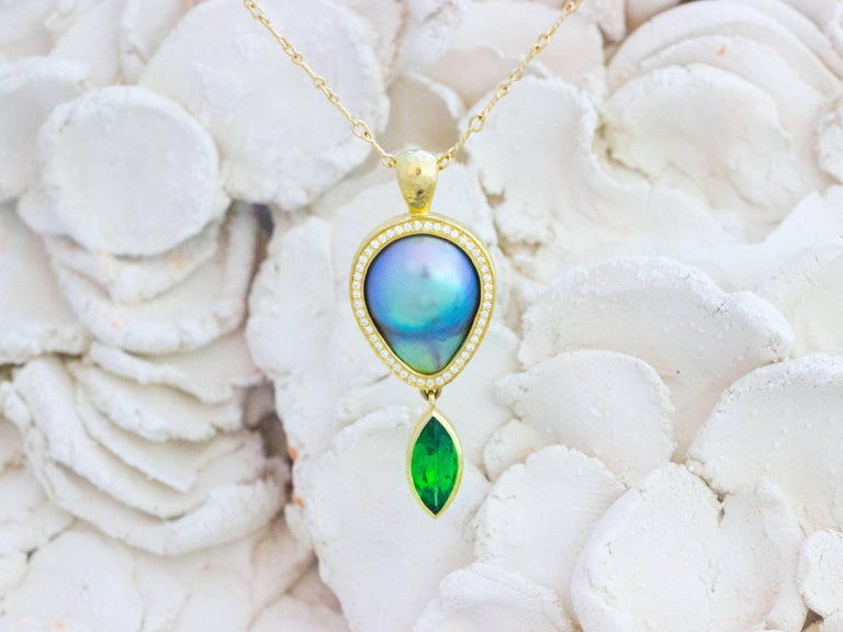 A celebration of color and phenomenal gems. Opals, sapphires, diamonds, tsavorite and a mabe pearl celebrate together in this convertible necklace. Hand fabricated (see