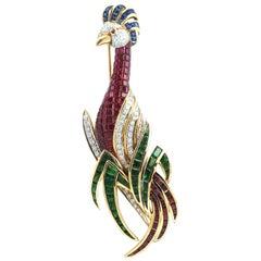 Tsavorites, Ruby, Blue Sapphire with Diamond Bird Brooch in 18 Karat Gold
