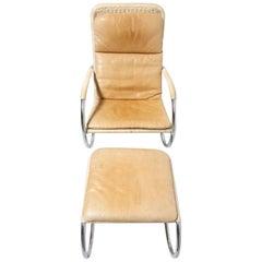 Röhrenförmige Lounge Sessel mit Polsterhocker von Tecta