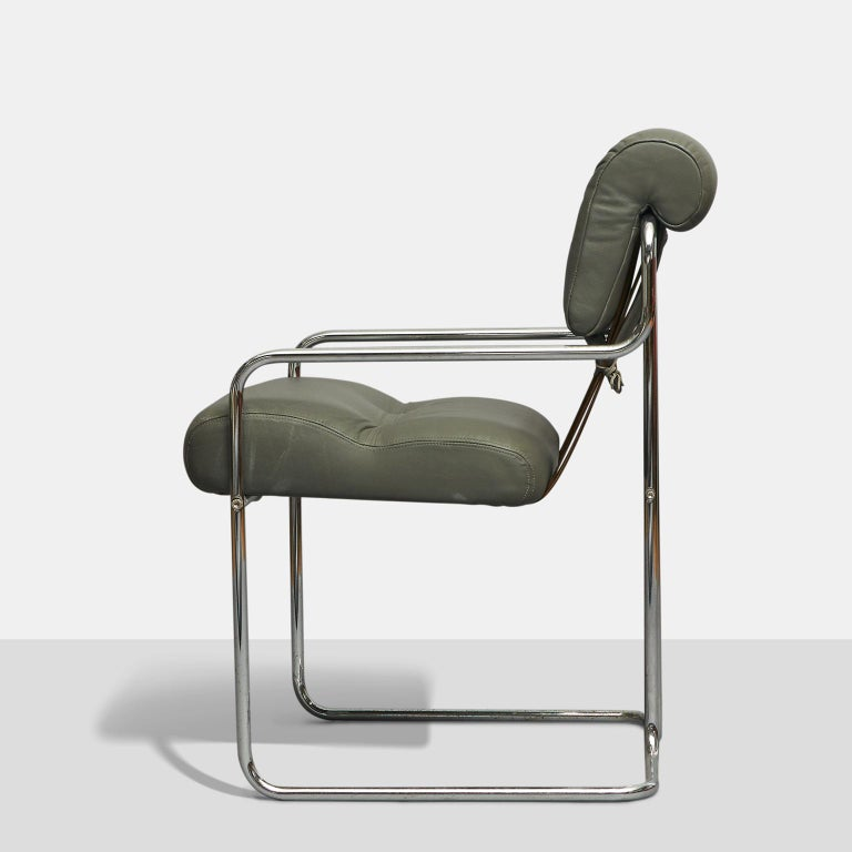 A set of Tucroma dining chairs designed by Guido Faleschini in 1972 and produced in Italy by Mariani for Leon Rosen's Pace Collection. Simple tubular chrome base with soft grey leather upholstery. Leather lacing in the back with leather straps.