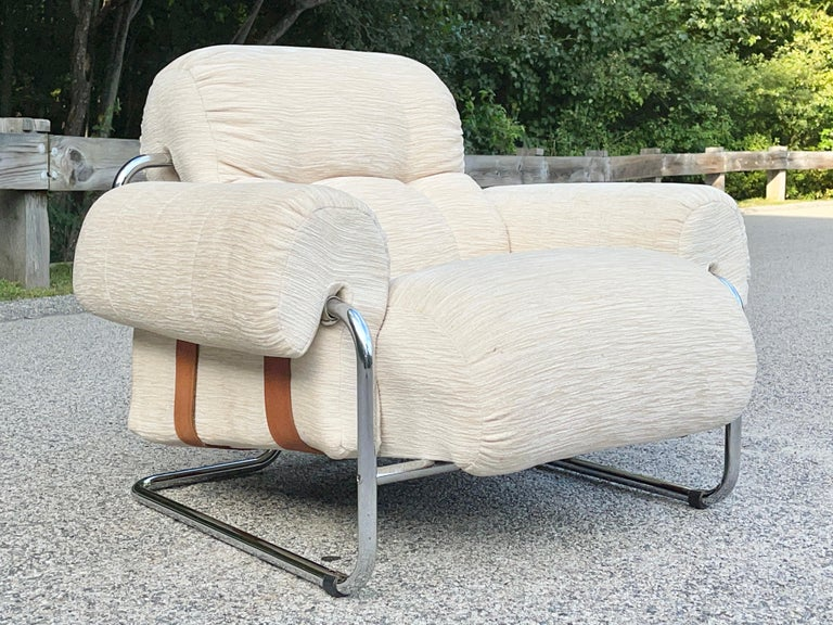 This is the rarely found lounge chair version of the iconic dining chairs designed by Guido Faleschini and produced by Mariani Italy for The Pace Collection in the early 1970s.  Tubular chromed steel frame, loose button tufted sculpted foam