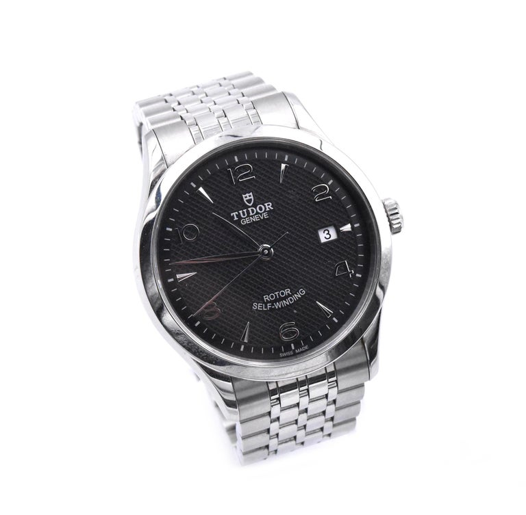 Movement: automatic Function: hours, minutes, seconds, date Case: round 41mm stainless steel case, screw-down crown, sapphire protective crystal Dial: black Arabic dial Band: stainless steel bracelet with fold down clasp Serial #: Q171XXX Reference