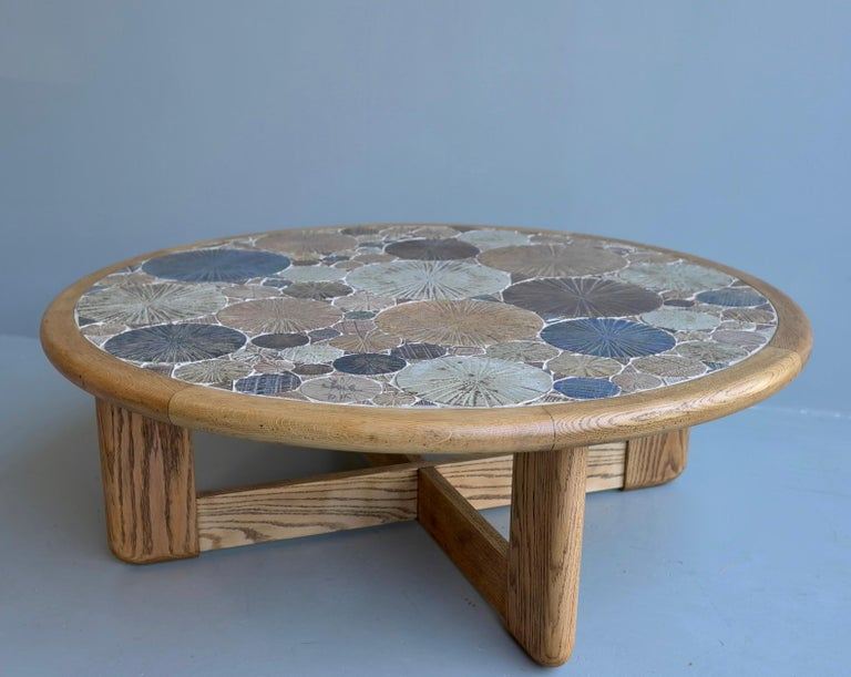 Tue Poulsen round ceramic and oak coffee table Haslev Møbelsnedkeri A/S, Denmark, 1963 Multi-color textured tiles were handmade by the Danish artist. Signed by the artist Tue DK.